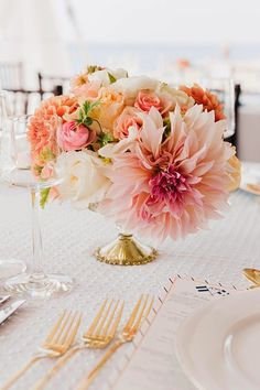 Elegant gold touches with coral + blush + ivory.