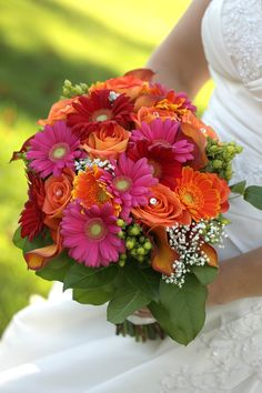 Bridal Bouquet of orange, pink and red gerbera daisy's, orange roses, hypericum berry and Calla lilys