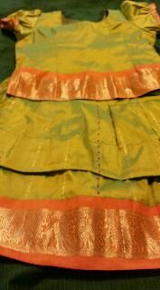 ♠♠♠... #KanchiSilk #PattuLanga in Green & Peach for kids!! This handmade #Kanchipuram silk pattu pavada is stylish and affordable...♠♠♠