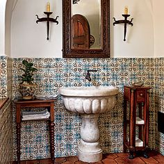 Thoughtful Reproduction: Thad went to great lengths to produce the kind of crafted details that confer a sense of authenticity. Hand-painted tiles and a marble basin are hallmarks of Mediterranean Revival style. The geometric tiles are from Ann Sacks. Spanish Bathroom, Spanish Style Bathrooms, Spanish Style Homes, Spanish House, Spanish Tile, Spanish Revival, Master Bathroom, Spanish Design, Downstairs Bathroom