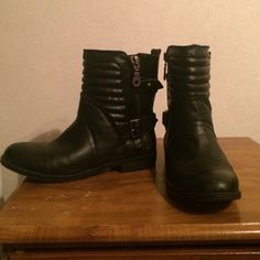 Black Moto style boots. Very nice boots with buckles and zippers. Metal is dark brass/gold in color. Boots cover a few inches above the ankles. Comfy to walk in. Only worn a few times. JustFab Shoes Combat & Moto Boots