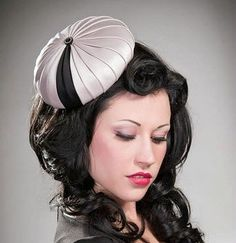 satin cocktail hat with black detail Makes me think of a parasol