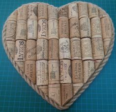 An upcycled idea for wine corks.  Here we have made a heart shaped cork board - which can either be used for pinning messages to, or just left as it is as a lovely wall decoration.  The (Greek) wine corks have been cut in half and glued to the board.  A layer of rope has been added around the edge to complete the piece.