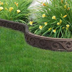Flexi-Curve Garden Edge  Model Number: MT5000926  |  Menards® SKU: 2680291: $10.99   Border is a sustainable product made of recycled materials. Eco-Trend™ Decorative Garden Edge is very easy to install: straight and curved formations are easy with the flexible rubber border.  •Included 5 spikes with every 4 ft. Eco-Trend™ garden edge that will easily secure the border in place  •Ideal for borders, gardens, walkways and more  Dimensions: 4 ft. Long x 2 in. wide x 4.25 in. High