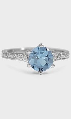 Delicate vintage inspired details combined with a stunning blue aquamarine make this ring absolutely breathtaking.