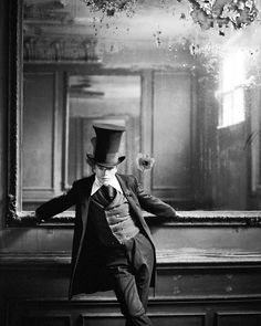 Victorian chap with the largest tophat I've ever seen [outside the circus]. The mirror isn't all that small either.