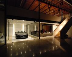 Amazing Car Showroom Design with Living Room: Awesome Garage Design The Car Cave Night View Sport Sedan Garage Loft, Garage House, Car Garage, Garage Design, House Design, Underground Garage, Ultimate Garage, Cool Garages, Showroom Design