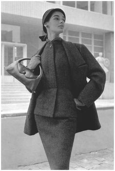 Jacky Mazel in slim wool suit topped with an ample jacket by Nina Ricci, Winter 1954-55