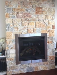 Summit Wall Cladding - most stone pieces on this fireplace have been squared off by the installer