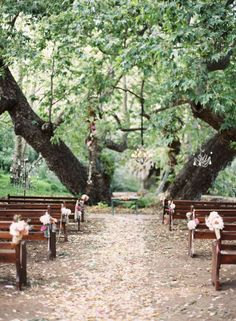 Pretty ceremony under a huge old tree. Lovely blooms & chandelier. Natural, bohemian, low key.