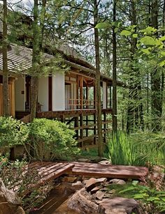 Phoenix residents Michael and Patricia Longstreth envisioned a traditional Japanese home, or minka, for their property on Arizona's Mogollon Rim. They enlisted her uncle, the late landscape architect Mits Murakami, to collaborate with them on the execution, naming the house Matsuyama Betso. Above: The main house is ringed by ponderosa pines.