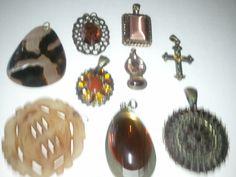 3 pendants - tortoiseshell pendant, top left. Oval w/amber teardrop, bottom center. brn amber/chinese, bottom left.
