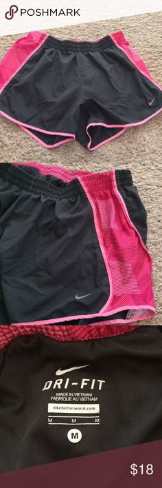 Nike Running Shorts✔️ Built in underwear(never used as underwear though) (normal Running Shorts kind) , just like new condition, dark gray and pink, very cute!! Nike Shorts