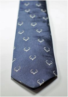 Sky blue and white stag head silk tie. Hand woven in Suffolk, England by Lissom and Muster