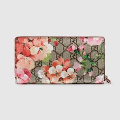 9846ca3d3abc Shop the GG Blooms Supreme zip around wallet by Gucci. A zip around wallet  in