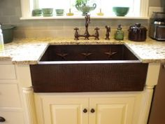 Copper Farmhouse Sink love this with distressed cream cabinets!
