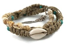 Hemp! An eco friendly and beautiful choice!  This is a hand woven real seashell anklet/bracelet made with natural hemp and cowrie shell with Czech glass bead detail. The glass beads are an eye catching turquoise....perfect for the beach!  Choose your length at checkout and decide of you want a longer length, for an anklet, or a shorter length, for a bracelet. All anklet/bracelet sizes will come with one cowrie shell and at least 6 glass beads. All come with a loop and tie closure for secure…