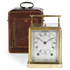 Paul Garnier No.487. A brass repeating carriage clock, Paris  silvered engine-turned dial, the repeating bell striking movement with replaced lever platform escapement, signed and numbered on the backplate Paul Garnier, Paris, 487, the moulded 'one-piece' case with removable front and top panels; together with the original travelling case