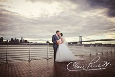 Even the rain couldn't stop these two from shining! #ClairPruettPhotography #WeddingPhotography #Wedding #Photography #AdventureAquarium #PhillySkyLine #SkyLine #RealCouple #RealWedding #Bride #Groom #NewJerseyWeddings #PhillyWeddings