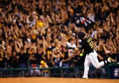 Former Yankee catcher Russell Martin and ex-Met outfielder Marlon Byrd blasted solo home runs one batter apart Tuesday night and powered the Pirates in Pittsburgh's first postseason game in 21 years.