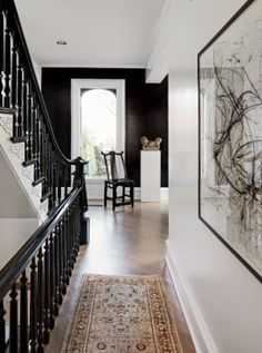 An 1880s Lincoln Park Graystone, Beautifully Redesigned | Chicago magazine - LOVE the black staircase against the black accent wall, magnificent!