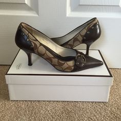 Coach heels size 7.5 Brown Coach logo heels. authentic and gently used, but in great condition. Still in box. Coach Shoes Heels