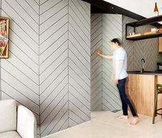 A wall feature that hides the entrance to a bedroom.