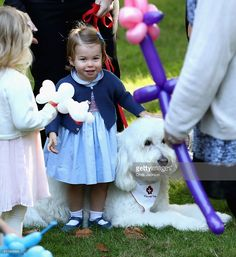 Princess Charlotte of Cambridge plays with a dog named Moose at a children's party for Military families during the Royal Tour of Canada on September 29, 2016 in Victoria, Canada. Prince William, Duke of Cambridge, Catherine, Duchess of Cambridge, Prince George and Princess Charlotte are visiting Canada as part of an eight day visit to the country taking in areas such as Bella Bella, Whitehorse and Kelowna