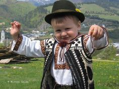 A young son of nature wearing the traditional costume