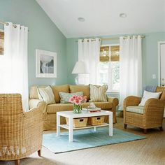 my living room color combo will end up opposite ways but still same colors I hope. Im loving this combo! A blue, tan, and white color scheme gives this living room a relaxing feel. More living room color schemes: www.bhg.com/...