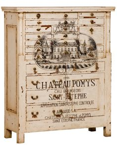 The French Wine Label Chest features hand-painted vineyard art work over a creamy off-white, distressed finish. The artwork features a painting of a French chateau and wine label lettering in French. Shop painted French chests now.