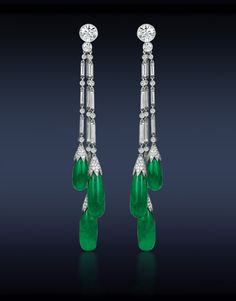 Gubelin Certified Colombian Emerald Drop Earrings, Featuring: Gubelin Certified 31.00 Tcw Green Colombian Emerald Drops (6 Stones) Highlighted with 5.03 Ct Round and Baguettes Cut Diamonds. Mounted in Platinum.