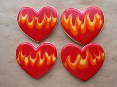 Hearts of Fire - Valentine's at my daughter's class. She likes the fire hearts. Toba's icing over butter cookies.