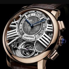 Cartier Rotonde de Cartier Earth and Moon - Cartier are releasing six pieces in preparation for SIHH 2016. One of them is this beautiful version of the Rotonde De Cartier Earth and Moon with a new meteorite dial! This version also has an 'on demand' moon phase function. The pusher at 4 will move the meteorite circle over the tourbillon covering it. Another push of the button will locate the disk into the current moon phase. On the 'Earth' dial a 24 hour indication can be seen around the…