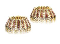 A PAIR OF FINE ANTIQUE DIAMOND AND RUBY PAIZEB   Each anklet designed as a series of hinged gold panels set alternately with graduated old-cut diamonds and rubies, surmounted by a row of pearls and suspending a fringe of old-cut diamond collets, Deccan, 19th Century, inner diameter 17.0 cm each