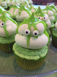 Slimer cupcakes for my grandson's 4th Ghostbuster's birthday party. Cupcakes are topped with buttercream, then a meringue ghost cookie, slime and eyes.