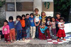 Rom's camp Casilino 900.Grandmother and Grandchildren Roma Bosnians