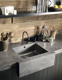 The Rich Colour And Texture Of Reclaimed Cabin Wood Is Perfectly Matched By Dark Granular Palette Corian Lava Rock Used For Kitchen Worksurface