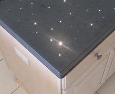 An illuminated concrete countertop featuring fiber optic lighting. The Concrete Countertop Institute has been offering classes for incorporating fiber optics into counters since 2006.