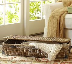 Daytrip Lidded Underbed Basket #potterybarn - on top of basket trunk to make side table for upstairs sofa?  Top with tray and table lamp....