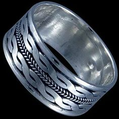 Silver ring, band Silver ring, Ag 925/1000 - sterling silver. A wide band with interweaving patterns.