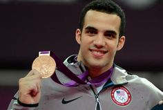 Team USA's Danell Leyva poses with his bronze medal from the London Olympics men's gymnastics all-around final.
