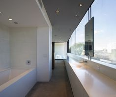 The master bathroom and dressing room join the master bedroom as one open suite.