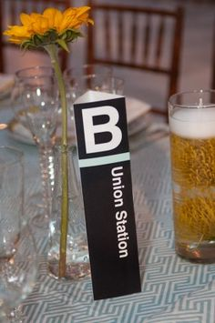 metro signs for table numbers. cute dc themed idea that isnt too corny...
