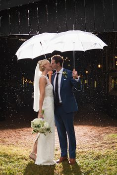 If it rains, make the best of it with an adorable photo like this! Krista Lee Photography: Jenny and Brandon Holleran / Cedarwood Wedding, Nashville TN #photography #wedding #rain #umbrellas #bride #groom #nashville #tennessee #cedarwood