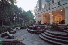 Stone patio with steps and scenic views.