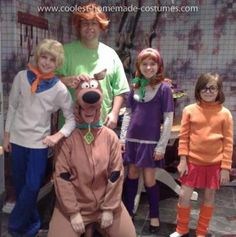 Homemade Family Scooby Doo Costume: Every Halloween we like to host a Halloween party and keep our costumes a secret! One year we went as Scooby Doo! We bought the Scooby Doo costume and