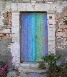 Blue and green wood door