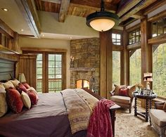 Love the rustic feel of the exposed wood beams, large windows, and fieldstone fireplace. With a great view this would be bedrooms house design interior design interior decorators de casas Country Master Bedroom, Dream Bedroom, Home Bedroom, Bedroom Ideas, Bedroom Decor, Master Bedrooms, Warm Bedroom, Wall Decor, Bedroom Retreat