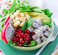 dragon fruit salad with avocado, chickpeas, pomegranate and sprouts